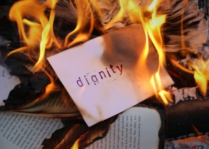 "Image of the word ""dignity"" about to go up in flames"