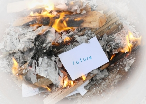 "Image of fire, with the word ""future"" on a notecard"